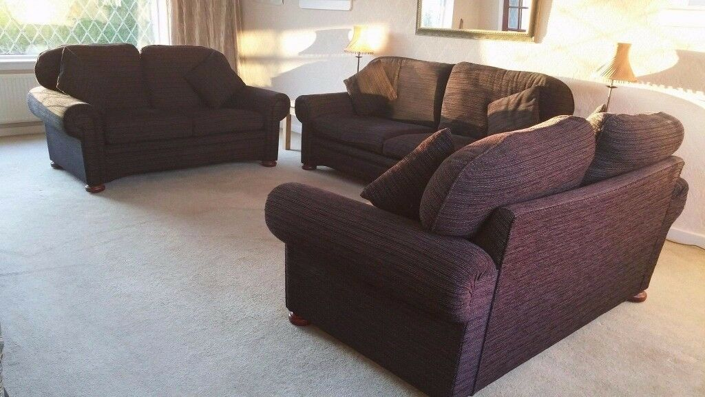 Sofa in black designer fabric with scatter cushions. Mahogany castor feet. One still available.