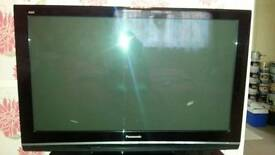 Panasonic 46inch plasma tv and black glass tv stand