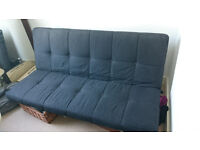 A second hand Kyoto Cube futon sofa bed (double) Mattress is black and made from foam. Pick up only
