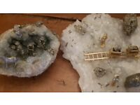 Two cyrstal geodes with mining scenes