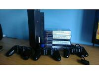 PS2 with games memory cards and controller s