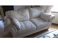Cream sofa 3 seater and armchair, 18 months old, duvet infills, excellent condition was £1800 new.