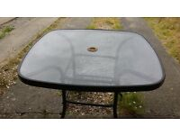 glass and metal table lovely some rust and wear but could use as it is sits 4 has holr for umbrella