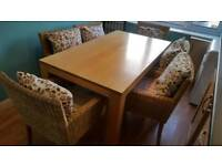 Dining Table and 6 Wicker Arm Chairs