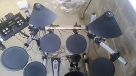 Yamaha dtx 500 drums in very good condition reluctant to sale but my son needs space .