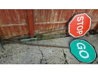 2 stop and go signs