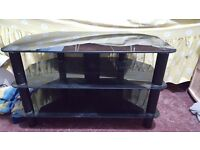Black glass TV stand collection only. Used but in good condition.