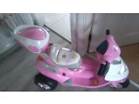 Pink battery scooter
