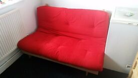 Red futon 6months old. Hardly used.