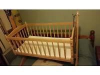 Swinging baby crib with mattress