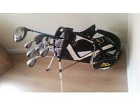 Golf Club set and carry bag. 11 clubs including driver, hybrid wood, irons, putter and sand wedge.