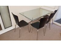 Tempered Glass dining table and 4 black chairs