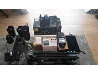 Nikon D3100 DSLR With A lot Of Extras.