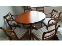 Beautiful cherry wood extendable dining table with modern chairs