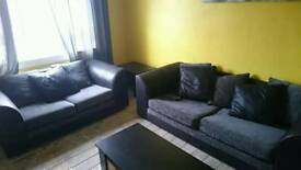 Two And Three Seater black and grey sofa