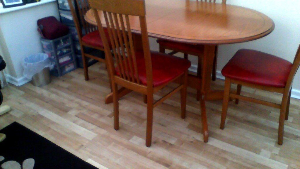 extending dining table and 4 chairs, expensive when new, a bargain! now sold!!