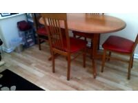 extending dining table and 4 chairs, expensive when new, a bargain!