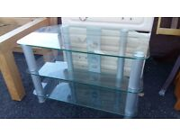 Glass TV table unit in excellent condition. Delivery can be arranged.
