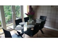 Habitat glass dining table with 6 chairs