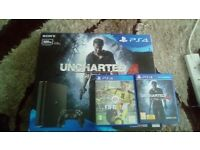 ps4 slim 500gb boxed console with two games fifa 17 and uncharterd 4 both boxed