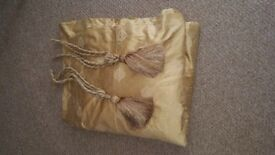 Pair of gold curtains with matching tiebacks
