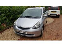 Silver Honda jazz. Good condition. One previous owner in family.