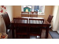 Mahoganey extendable dining table and 6x chairs