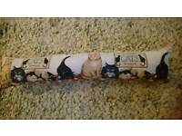 Draft excluder cats