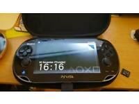 PS Vita (Wifi) + 16gb Memory Card + 2 games