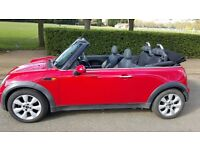A red good condition mini convertible for sale