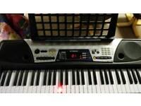 Yamaha EZ-150 electronic keyboard with stand
