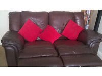 Brown Leather 2 seater reclining sofa £100 ono