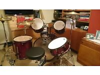 Pearl Forum 'Red Wine' 5-piece drum kit (inc. 3 cymbals and stool) + set of silencer pads + brushes.