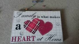 Family is what makes a heart at home wall hanging.