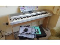 Electric Piano Yamaha PortableGrand DGX-505 with stool, pedal, cover and two music books