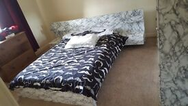 Double bed with unique marble effect finish - great condition