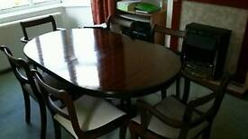 6 seater extendable wooden table with 6 chairs