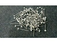 Plastic top nails. 40mm long stainless with white plastic head. Pack of 100