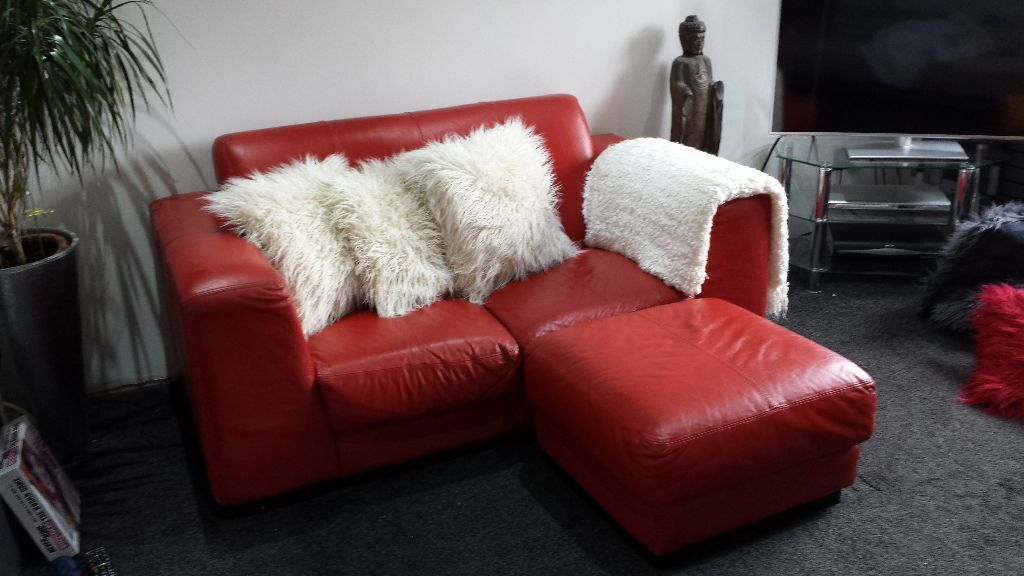 DFS RED LEATHER 2 SEATER SOFA SETTEE AND MATCHING POUFEE