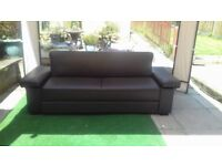 Brown sofa settee bed