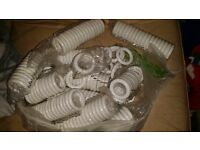 Free bag of white wood curtain rings