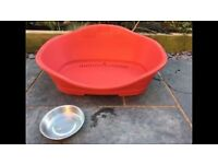 Large red plastic dog bed (used)