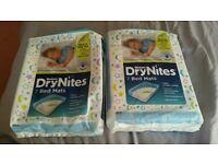 2 x opened packs of Huggies DryNites Bed Mats 9 mats in total