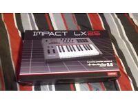 Nektar Impact lx25 midi electronic keyboard