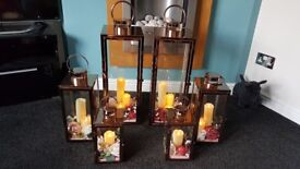 6x rose gold/ copper lanterns with flowers and LED candles. Wedding/ Bridal decoration.