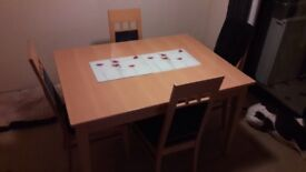 Extending dining room table & 6 chairs