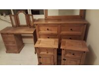 Wooden chest of draws bedside tables dressing table and wall mirror and dressing table mirror