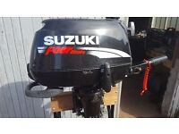 Suzuki 4 hp four stroke outboard motor with stand