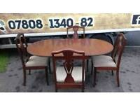solid mahagany drop leaf table and 4 chairs ( MINT MINT CONDITION)
