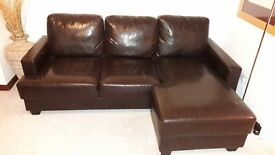 1 Brown Leather 3 seater corner unit. Left corner extended out.